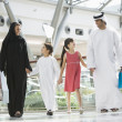 Middle Eastern family in shopping mall — Stock Photo #4760692