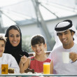 A Middle Eastern family enjoying a meal in a restaurant — Stock Photo #4760710