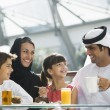 A Middle Eastern family enjoying a meal in a restaurant — Stock Photo #4760711
