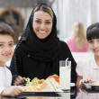 A Middle Eastern family enjoying a meal in a restaurant — Stock Photo #4760724