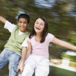 Two children having fun on roundabout — Stock Photo