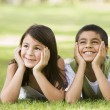 Stock Photo: Two children relaxing in park