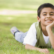 Boy relaxing in park — Stock Photo #4760750
