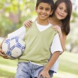 Children playing football in park — Stock Photo