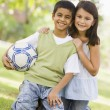 Stock Photo: Two children playing football in park