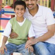 Stock Photo: Father and son in playground