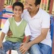 Father and son in playground — Stock Photo #4760785