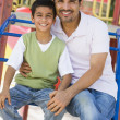 Father and son in playground — Stock Photo #4760787