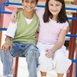 Two children in playground - Foto Stock