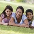 Mother and children having picnic — Stock Photo #4760811