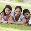 Mother and children having picnic — Stock Photo