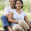 Couple relaxing in park — Stock Photo