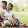 Couple relaxing in park — Stock Photo #4760826