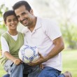 Father and son playing football — Stock Photo #4760843