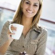 Woman enjoying snack at cafe — Stock Photo #4760849