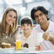 Family having snack at cafe — Stock Photo #4760859