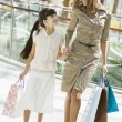 Mother and daughter shopping in mall — Stock Photo