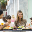 family enjoying lunch at cafe — Stock Photo