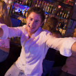Young man in nightclub approaching camera with arms outstretched — Stock Photo #4760941