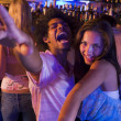 Young man and young woman dancing in a nightclub — Foto de Stock