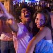 Stock Photo: Young man and young woman dancing in a nightclub