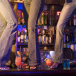 Three young women dancing on a bar counter - Foto de Stock