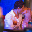Young couple kissing in a nightclub — Stockfoto