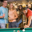 Young adults playing pool in bar — Stock Photo #4761018