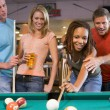 Young man teaching a young woman to play pool — Stock Photo #4761019
