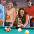 Young man teaching a young woman to play pool — Stock Photo #4761023