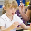 Stock Photo: Schoolgirl in primary class