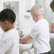 Children washing their hands in a primary school bathroom — Stock Photo #4761165