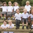 Young children sitting on benches and yelling — Stock Photo