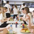 图库照片: High school students eating in school cafeteria