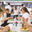 High school students eating in the school cafeteria — Stock Photo #4761222