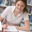 Girl student studying in library — Foto Stock