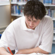 Student studying in library — Stock Photo