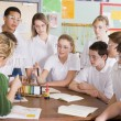 Schoolchildren and teacher in science class — Stock Photo #4761276