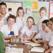 Schoolchildren and teacher in science class — Foto Stock