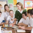 Schoolchildren and teacher in science class — Stock Photo #4761286
