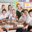 Schoolchildren and teacher in science class - Stock Photo