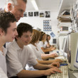 Row of schoolchildren studying in front of a computer — Stock Photo