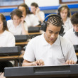 Schoolchildren practicing on a keyboard in music class — Stock Photo