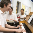Schoolboys playing musical instruments in music class — Stock Photo