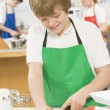 Royalty-Free Stock Photo: Schoolboy at school in a cooking class