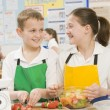 Schoolchildren at school in a cooking class — Stock Photo