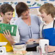 Schoolchildren and teacher at school in a cooking class — Stock Photo