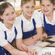 Schoolgirls in woodwork class - Stock Photo