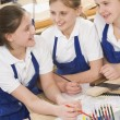 Stock Photo: Schoolgirls in woodwork class