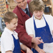 Stock Photo: Schoolboys and teacher in woodwork class